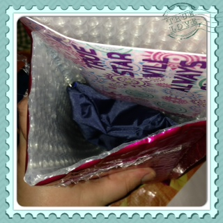 Deep in the metallic pink package is a make-up nag and...
