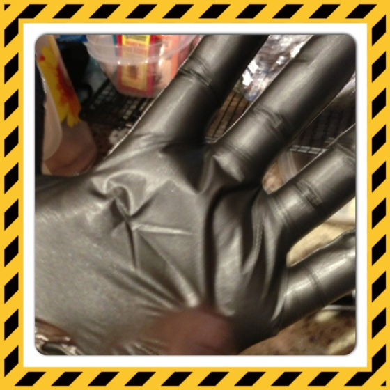 As you can see, my hand is stretching out the glove. My hands are HUGE- they are bigger than my husband's. Ridiculous.