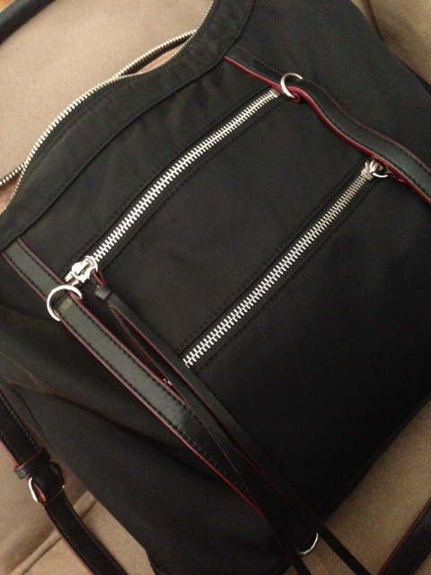 Nylon with leather trim, this bag can take a beating. I am super hard on my bags and after a year of pretty frequent use, it still looks good.